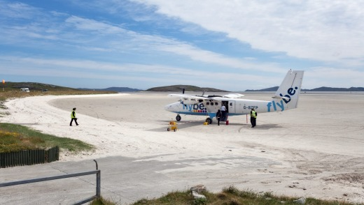 The world's shortest flight: Loganair makes the world's only scheduled beach landing at Barra, in the Western Isles of ...