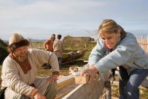 Discovering the art of Viking boat building at L?Anse aux Meadows in Newfoundland, Canada. Interpreter in period costume ...