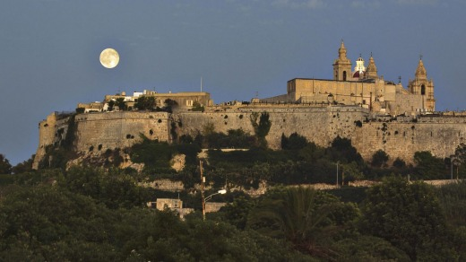 Moonlight over Mdina's fortified walls.