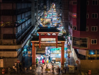 Temple St night market in Hong Kong is a crazy, frenetic row of stall after colourful stall. Wanting to get a ...