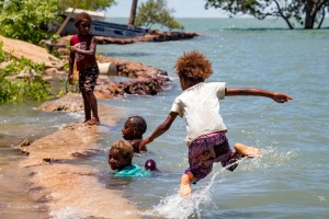 Children on Saibai island swim in the tides.