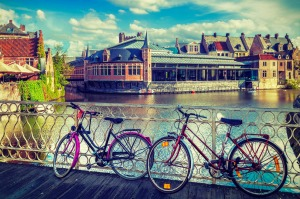Travelling by bicycle offers great views of historic cities such as Ghent.