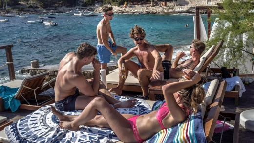 A group of tourists at the popular Hula Hula beach bar on Hvar, Croatia.