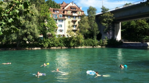 Swimmers make the most of the Aare River whenever the sun shines in Bern.