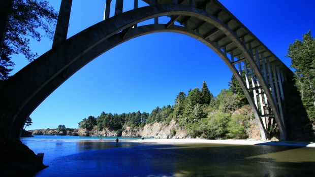 A bridge on Highway 1 crosses Russian Gulch State Park along the Mendocino coast in Northern California.