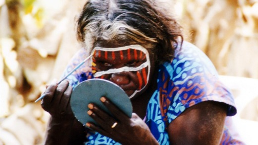 Bathurst islander Mary paints her face in preparation for performing some Tiwi dances for visitors to the islands.