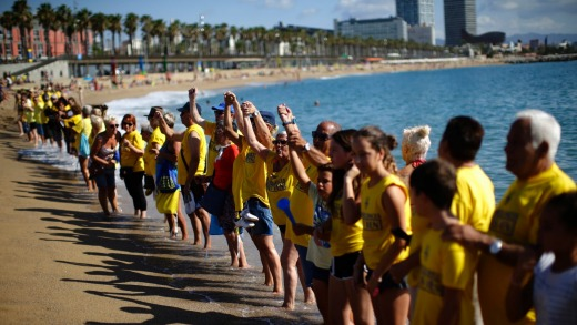People form a human chain during a protest against tourism in Barcelona.