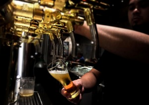 Four gleaming tanks greet patrons behind the bar at this small, family-run microbrewery and restaurant operated out of a ...