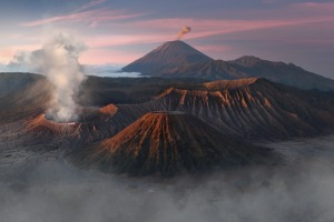 A view of Mount Bromo and Mount Semeru spewing ashes while Mount Batok remains inactive in the island of Jawa, Indonesia.