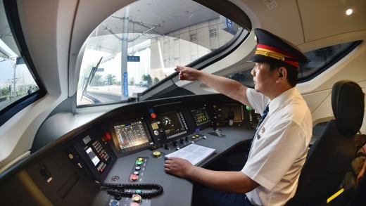 A train driver prepares to operate the Fuxing bullet train.