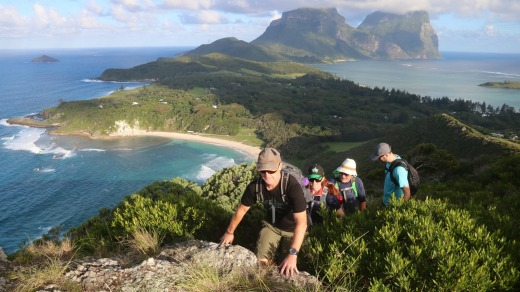 Lord Howe Island's Seven Peaks Walk: Malabar Hill overlooking Neds Beach with Lidgbird and Gower in the background.