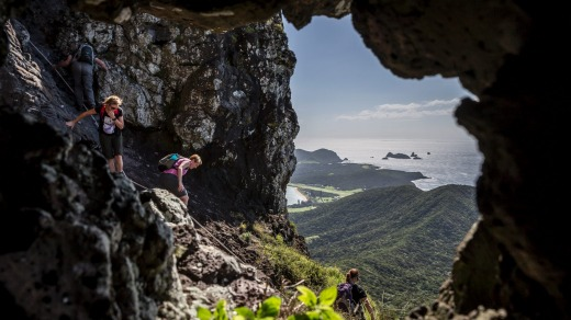 Walkers descending from Goat House Cave on Mt Lidgbird.