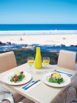 At the beach: Dining at Sails Restaurant, Hastings Street, Noosa.