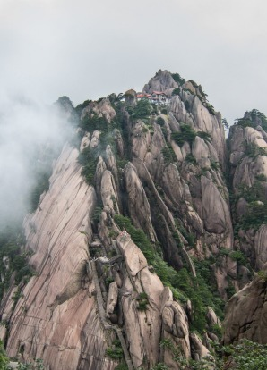 One of the world's craziest hotels perched at the top of a peak in Huangshan.   To get there, one has to climbed ...