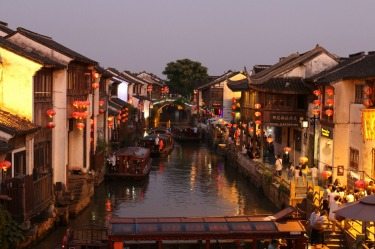 The bustling watertown of Suzhou is at its most beautiful at dusk with the markets and brightly lit lanterns came to live.