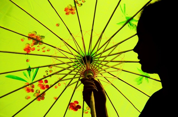 My daughter posing with her new souvenir parasol in Hoi An, Vietnam.