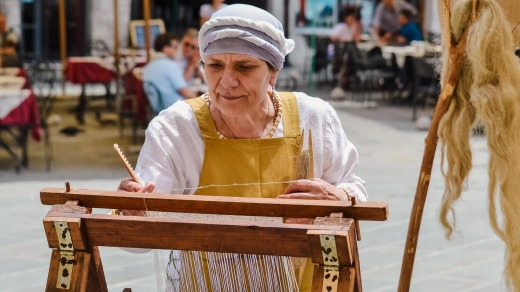 Weaving at a historic medieval festival in Perugia, Italy.