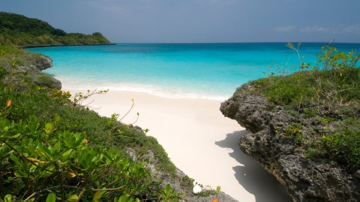 Lifou, in the Loyalty Islands. Excursions here focus on the coves, limestone caves, grottos and compressed coral cliffs, ...
