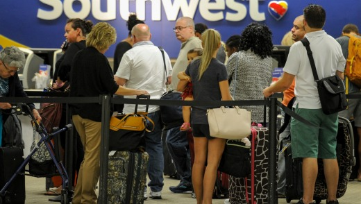 Passengers wait in line at the Southwest Airlines ticket counter Wednesday, Sept. 6, 2017 at Tampa International ...
