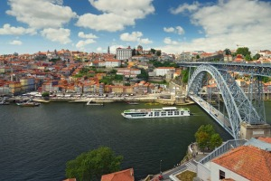 The Scenic Azure passes under the Dom Luis I Bridge in Porto.