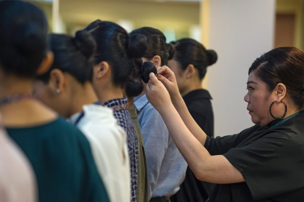 Inside Singapore Airlines flight school: Each new recruit (male or female) goes to grooming lessons. The women are told ...