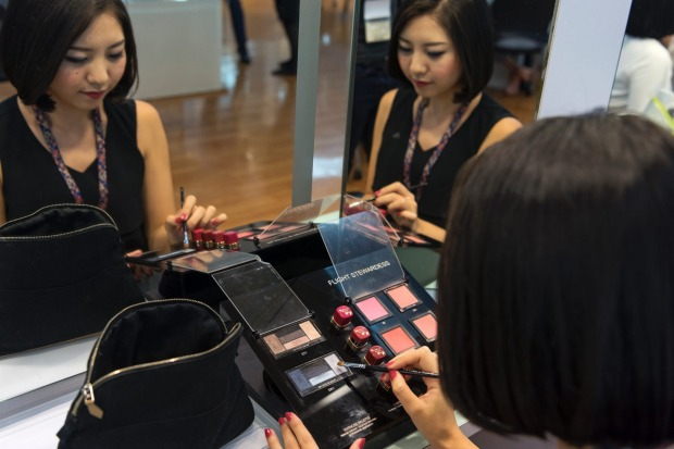 Inside Singapore Airlines flight school: Each new female recruit has one half of her face dressed in blue eyeshadow, and ...