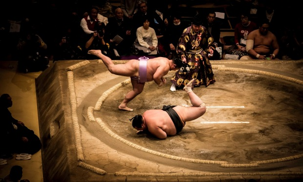 Sumo tournament Tokyo January 2017.   After much ceremony the wrestlers step into the ring and fight.  It is all over in ...