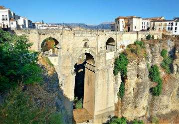 Beautiful Ronda, in the Malaga province of Spain, is set high on the clifftops over the El Tajo gorge.  The 18th century ...