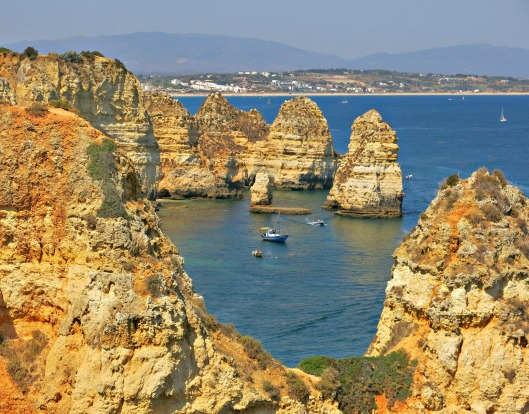 The stunning cliffs of Ponta de Piedade in Lagos, Portugal, reminded me of Victoria's Twelve Apostles.  Exploring the ...