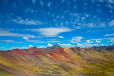 You feel so small when you are surrounded by the overwhelming and jaw-dropping beauty of the rainbow mountains in Peru. ...
