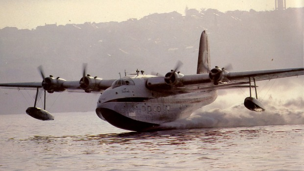 An S25 VH-BRC' Beachcomber' taking off from Rose Bay.