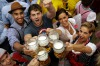 Young people celebrate the opening of the 184th Oktoberfest beer festival in Munich, Germany, Saturday, Sept. 16, 2017. ...