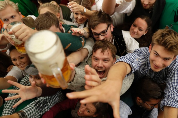 People celebrate the opening of the 184th Oktoberfest beer festival in Munich, Germany.