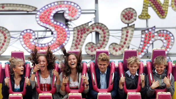 Felice, Emilia, Marisa, Laurin, Leo and Emil enjoy a fairground ride at the opening day of the 184th Oktoberfest beer ...