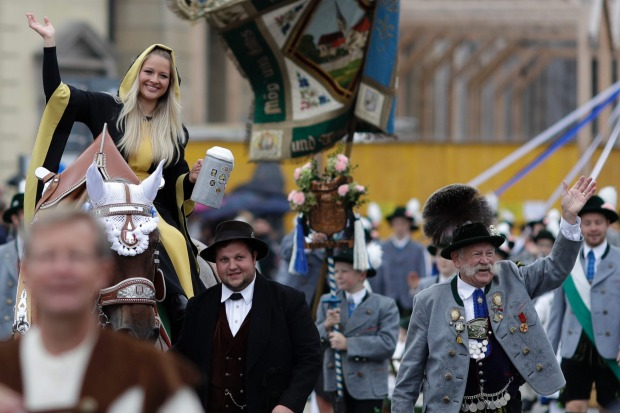 A young woman dressed as 'Muenchner Kindl' participates in the traditional costume and riflemen parade on the second day ...