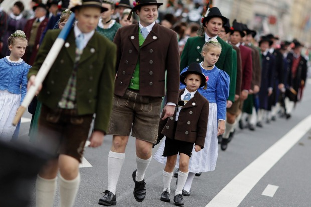 Children participate in the traditional costume and riflemen parade on the second day of the 184th Oktoberfest beer ...