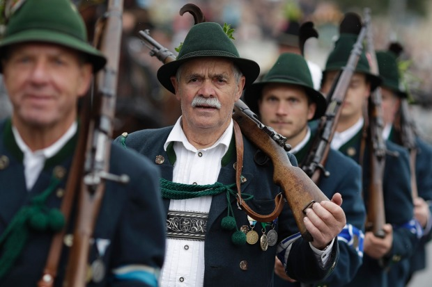 People participate in the traditional costume and riflemen parade on the second day of the 184th Oktoberfest beer ...