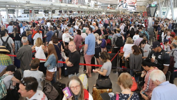 """Crowds gathered at Sydney Airport after delays stemming from a """"technical issue""""."""