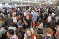 "Crowds gather at Sydney Airport with delays expected due to a ""technical issue""."