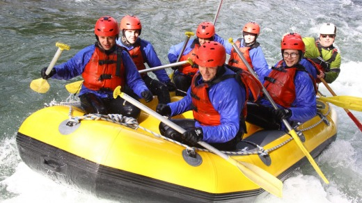 Tongariro River Rafting trip with owner Garth Oakden in yellow at the back.