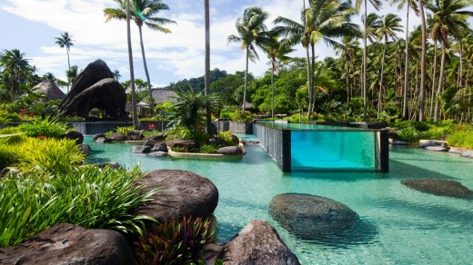 Laucala's spectacular glass-sided swimming pool.
