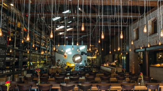 Dangling light bulbs are a feature at Bread in Common, Fremantle.