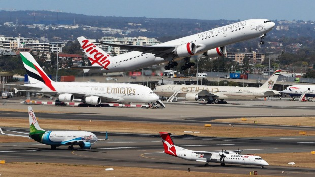 A plane takes off at Sydney Airport.