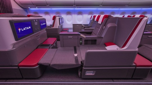 Each grey and red seat reclines fully to a flat-bed 23 inches (58 centimetres) wide and 73 inches (185 centimetres) long ...