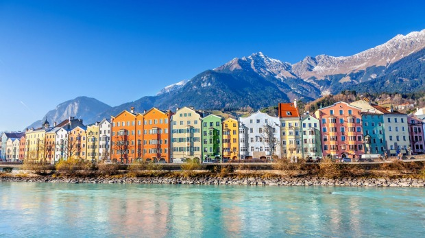 Innsbruck is surrounded by mountains.