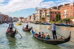 Gondola on Canal Grande in Venice, in a beautiful summer day in Italy SunOct15coverexp