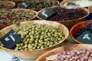 Olives glisten like river pebbles.