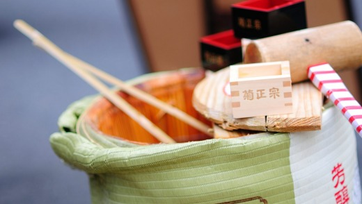 Sake barrel, opened with the hammer, during the New Year's pilgrimage of the Seven Gods of the Good Fortune shrines in ...