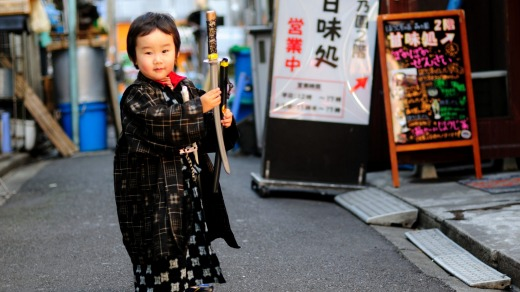 Small boy in traditional costume on the streets of Ningyocho.