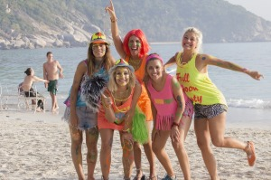Backpackers at a beach in Thailand for a full moon party.